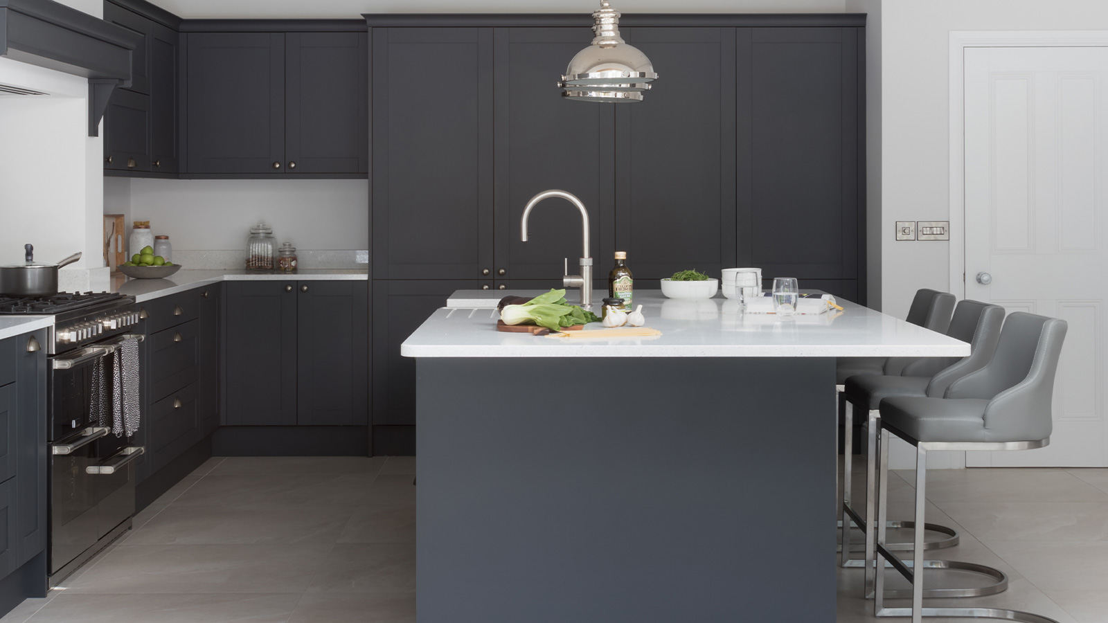 A luxury classic kitchen with grey shaker cabinets