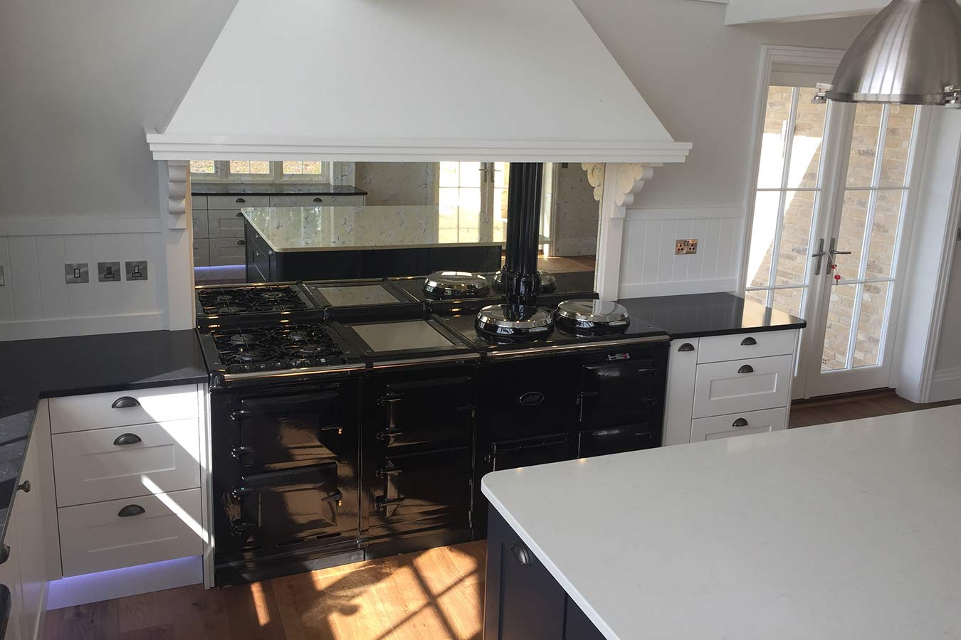 Masterclass Kitchens Mirror Splashback in a Shaker Kitchen
